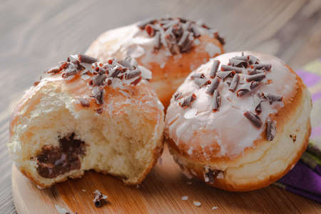 Traditional Polish donuts with a filling, donuts with jam, donuts with chocolate