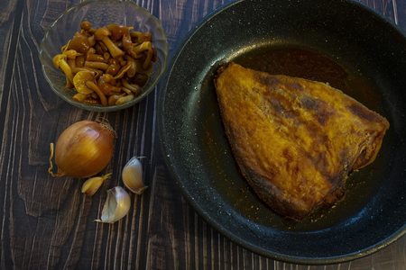 Fried flounder in a pan. Home cooking in a rustic style. 写真素材