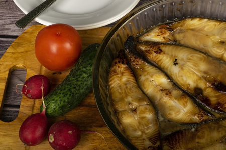 Halibut steaks baked in a glass dish. In soy sauce with honey.