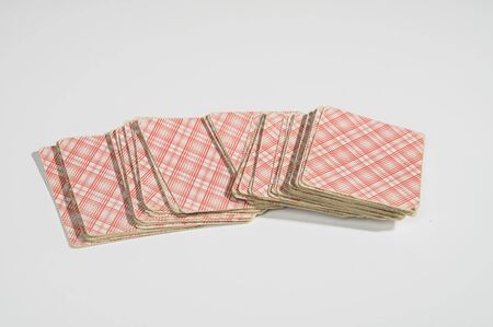 Playing cards on white background. Not isolate.