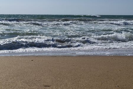 Black Sea. Summer storm. Waves lapping at the sandy beach