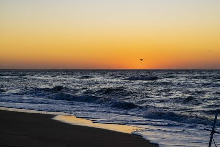 Sunrise over the Black sea, waves on the sandy beach 写真素材