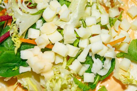 Leafy salad, sliced vegetables and pita sauce are the basis for homemade Shawarma. Close up