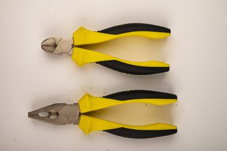 Different pliers on a white background. Close up. Manual locksmith and installation tools for home work