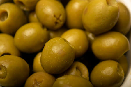 Green olives, the texture of the surface. Close up
