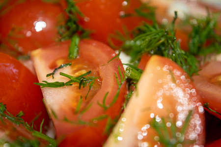 Vegetable salad. Sliced tomatoes with herbs. Close up Standard-Bild