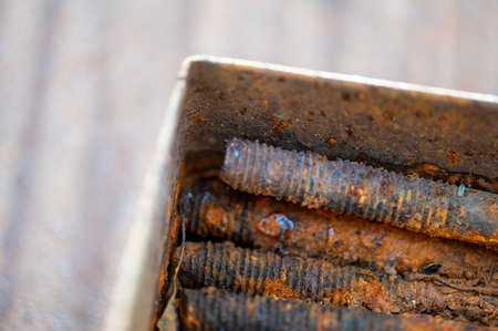 Old metal studs covered in rust, close-up, selective focus