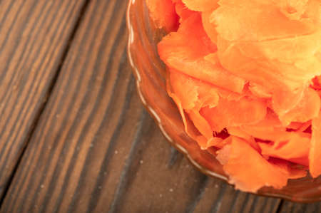 Pickled ginger in a glass dish on a wooden table. Close-up Selective focus 写真素材