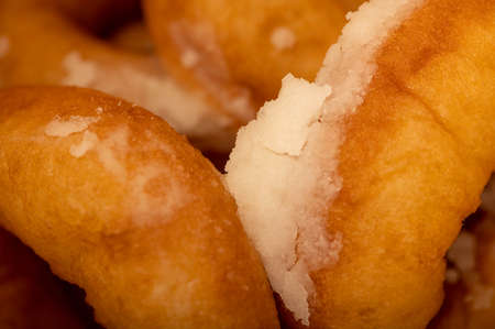 Fresh homemade donuts with powdered sugar. Close-up Selective focus