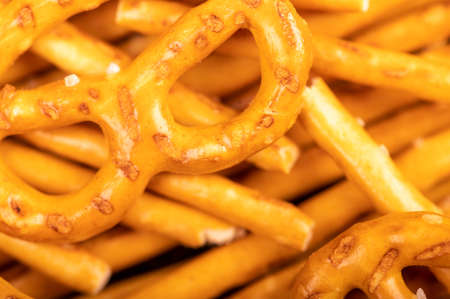 Bread sticks and bread figures with salt. Close-up Background image