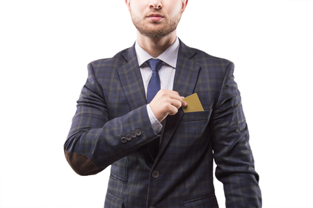 Charismatic man in a sui puts the card into his breast pocket