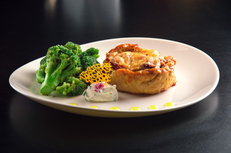 Delicious chopped steak from chicken fillet in addition to broccoli and tender cheese sauce