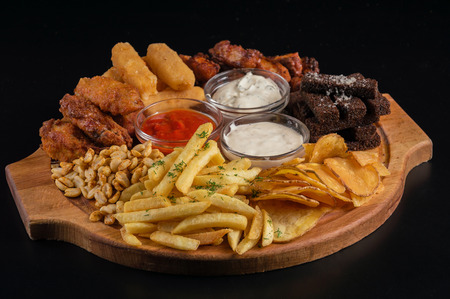 A huge set of snacks for beer Stock Photo - 81043508