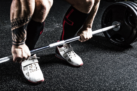 Professional powerlifter prepares for deadlift. View from above. Mixed media Stock Photo