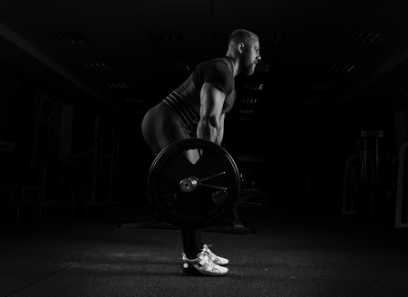 The weightlifter performs an exercise called deadlift. He fixed the weight Stock Photo