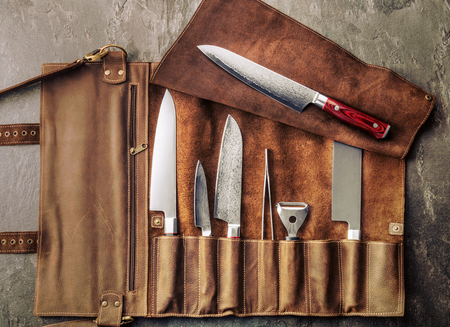Set of professional cook tools. Special case of cook knives. View from above Stockfoto