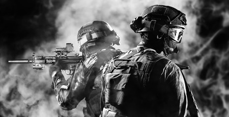 Group of fighters of a special unit covers the withdrawal of members of their team. Mixed media Imagens - 115842546