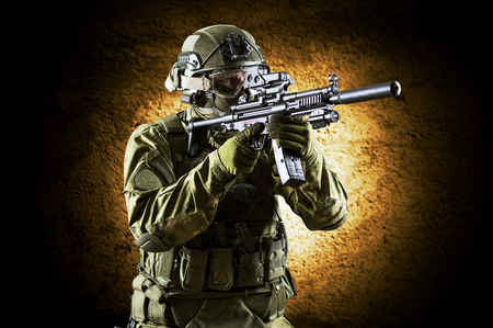 Fighter of a special unit is aiming at the sight of the machine gun.