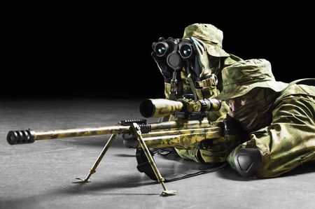 Sniper together with the gunner took the position and expect the target. Mixed media Imagens
