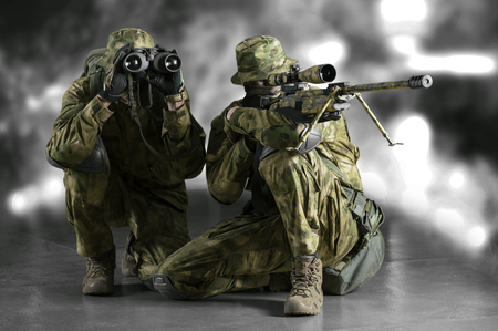 Group of snipers with a night vision device tracks the target. Imagens - 115911656