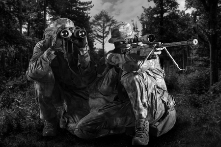 Group of snipers with a night vision device tracks the target.