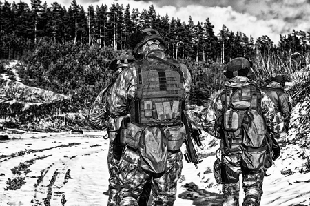 Two soldiers of a special unit are preparing to carry out a dangerous mission. Mixed media