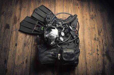 Set of equipment for scuba diving. The concept of sports, recreation, travel. Mixed media 版權商用圖片
