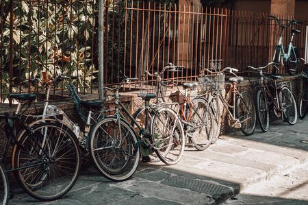 Florence street is full of bicycles. Tourism and travel concept. Mixed media