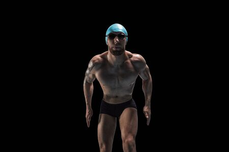 Portrait of a swimmer who is preparing for a jump. The concept of swimming and water games. Front view. Mixed media