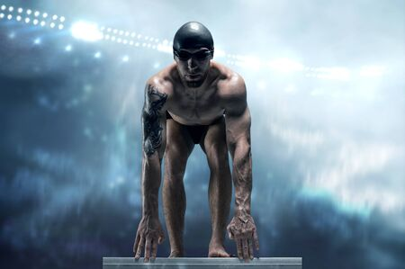 Portrait of a swimmer on the background of a sports arena. Athlete is preparing for the jump. The concept of swimming and water games. Front view. Mixed media