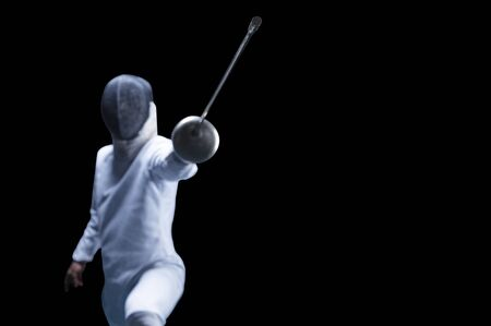 The fencer moves forward with a sword in his hand. Sport concept. Mixed media