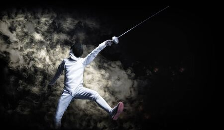 The fencer moves forward with a sword in his hand. Sport concept. Mixed media Standard-Bild