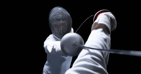 Two fencers are fighting in a tournament. The concept of fencing. Mixed media