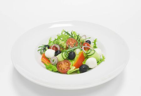 Classic greek salad. Top view. White background. Healthy eating concept. Mixed media