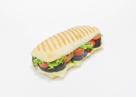 Gourmet panini with eggplant, tomatoes and cheese. Top view. White background. Healthy eating concept. Mixed media