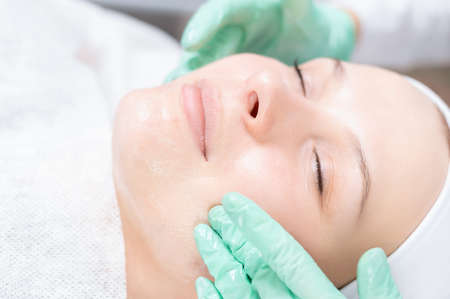 Portrait of a woman's face with problem skin. Peeling procedure. Natural beauty. Mixed media Reklamní fotografie