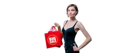 Portrait of stylish adult woman posing in studio on white background with red gift bag. Valentine's Day concept. Holidays and gifts. Mixed media