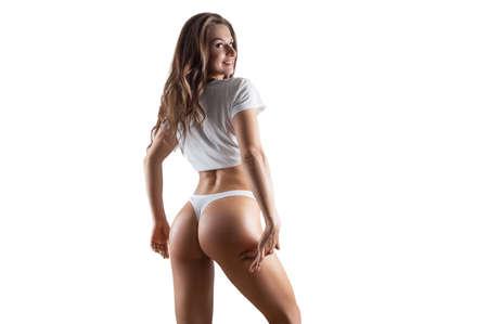 Beautiful woman posing in studio on a white background. Long legs. Skin care concept. Mixed media Foto de archivo