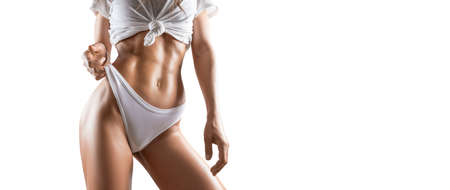 Image of a pumped up abs. Beautiful sportive woman posing in studio on a white background. Fitness, bodybuilding, aerobics concept. Mixed media Stockfoto