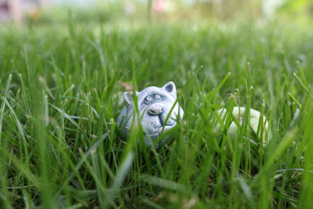 Figure of a hiding in the grass