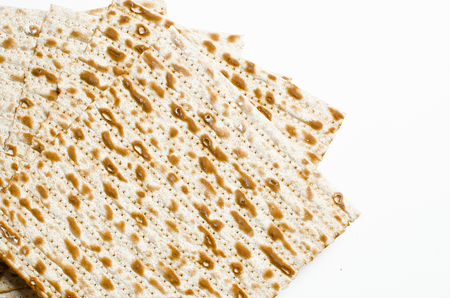 traditional Jewish kosher matzo for Easter pesah on a wooden table. Jewish Easter food. Spring.On a white background. Isolate Stock Photo