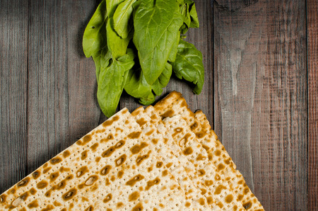 traditional Jewish kosher matzo for Easter pesah on a wooden table. Jewish Easter food. Spring.