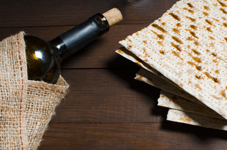 traditional Jewish kosher matzo for Easter pesah on a wooden table. Jewish Easter food