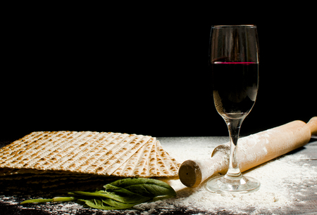 traditional Jewish kosher matzo for Easter pesah on a wooden table. Jewish Easter food. Spring.Family holiday Pesach.