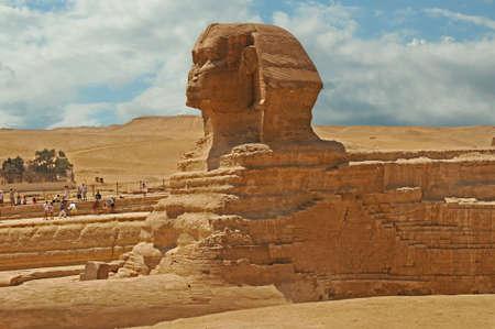 Sphinx against pyramids Stock Photo
