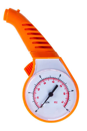 orange automobile manometer on a white background. photo