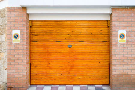 garage on house: wooden garage gate in the stone house