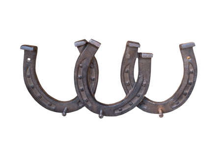 luck: Three rusty horseshoes on white background stacked Stock Photo