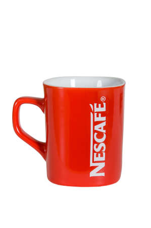 nescafe: Moscow, Russia November 08,2015: Studio shot of a red Nescafe cup isolated on white background.