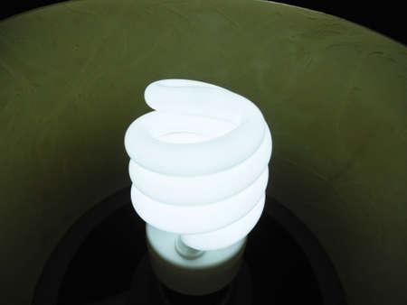 light duty: An energy saving light bulb on duty Stock Photo